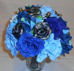 Mossy Oak Camo Bouquet, Blue Camo Wedding Bouquet, Camo Bridal Bouquet, Camo Bridesmaid Bouquet, Blue Silk Flowers, Brass Bullet Shells Let us create a bouquet for you that will last forever. THIS BOUQUET CAN BE MADE IN ANY COLOR FLOWERS WITH THE CAMO, WE CAN USE SHOT GUN SHELLS