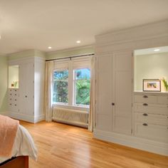 I have always said that when we build our house I want built in dressers and here it is!! master bedroom:  built-in dressers + closets; symmetry