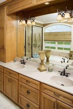 Master Bath of the Edgewater Plan 1009 http://www.dongardner.com/plan_details.aspx?pid=2695 - Promoting easy living, this home combines character with low maintenance. #Home #Designs #Craftsman #Bathroom