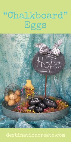 "To make these ""chalkboard"" eggs just paint paper mache eggs with black paint and use a white chalk marker to write the words. I think my favorite part of this Spring display is the felt baby chick propped in a rusty bed spring- it just makes me smile! The galvanized tray is a thrift store find and paper shreds are one of my ""go-to"" products to finish off a design. Check out more fresh Easter ideas here: http://destinationcreate.com/easter-mantel-hop-spring/ #easter"