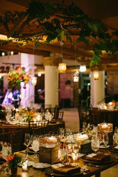 Ceremony designed to look like a romantic dinner in the forest #blisschicago #weddings #lovely #hangingcandles #tables #reception #secluded