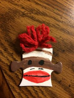 "Read More About Girl Scout Swap. Sock monkey just for fun! Glue red yarn hair to puzzle ""outie"" on top. Glue pin on back. Puzzle Piece Crafts, Puzzle Pieces, Monkey Crafts, Hat Crafts, Girl Scout Swap, Girl Scouts, Diy For Kids, Crafts For Kids, Crafting"