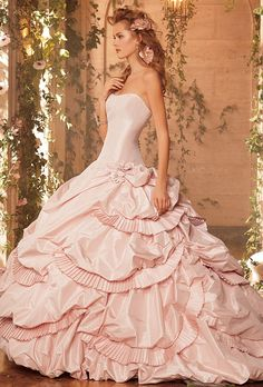 A gown that's not only blush, but lush in style, you'll definitely feel like the belle of the ball in this gown.