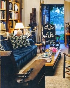 How do I love thee? The blue velvet sofa, the amazing upholstered side chair, and the way it's Rorshach-esque pattern coordinates with the throw pillows. Wow!