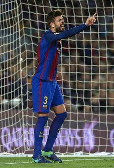 Gerard Pique of Barcelona reacts during the La Liga match between FC Barcelona and Malaga CF at Camp Nou stadium on November 19, 2016 in Barcelona, Catalonia.