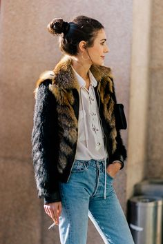 Diletta Bonaiuti wearing a Roberto Cavalli fur jacket and Levis jeans after the Fendi Fall/Winter 2015-2016 fashion show in Milan, Italy