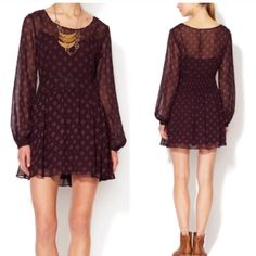 Free People Baby Dee Dress Free People Baby Dee Dress with dark plum w/4 dotted diamond like design. The dress is lined throughout the body and the sleeves are sheer. Beautiful piece for any occasion! So comfy too. I have only tried on, it came NWT but I took off to wash once and hung to dry. Free People Dresses