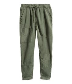 Khaki green. CONSCIOUS. Pull-on pants in Tencel® lyocell twill with an elasticized drawstring waistband and side pockets. Relaxed fit with gently tapered