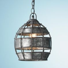 """Industrial Metal Weave Pendant Rustic iron slats assembled with hammered rivet nail heads expose the contents of decorative accents with masculine detaills in this industrial style pendant. The raw industrial quality adds an interesting dimension to a simple dome shaped pendant light.  60 watt medium base lamp required.  (11.75""""Hx8.75""""W)"""