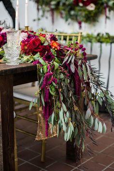 Stunning floral table runner | Photo by Dina Chmut via http://junebugweddings.com/wedding-blog/berry-wine-wedding-inspiration/