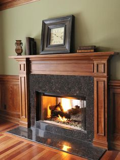 I like the color of this fireplace surround, perhaps we could sand down ours and stain slightly darker.
