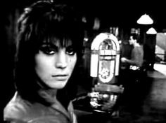Joan loves rock 'n' roll, so put another dime in the jukebox baby!