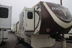 """STUPENDOUS 5TH WHEEL!!!  2016 Heartland Bighorn 3750FL With 5 slide outs, there is plenty of space for fun! A private master bedroom with extensive amounts of storage! Step down into the beautiful kitchen and make delicious meals! Step up into your massive entertainment room! Two couches and a love seat sit in front of your 55"""" LCD TV screen! Don't miss the big game! Relax outdoors under the shade of your awning and enjoy the day! Call our Bighorn expert Tim Belles 435-774-0086"""
