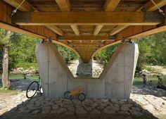 http://www.dezeen.com/2015/11/24/wooden-footbridge-dans-architects-slovenian-village/