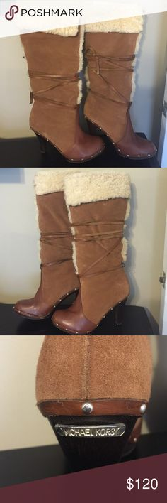 Michael Kors Vintage Shearling boots Michael Kors Vintage Shearling Clog boots with box. Tops can be rolled up to go above knee. Bottoms are made of dark wood with a 4 inch heel. Wrap around tie detailing. Color is chestnut. Style: 40F5CLHB6S. Size 10. Some signs of wear but only if you really inspect boots. When worn they look good as new!! These boots are fabulous!!! Michael Kors Shoes Heeled Boots