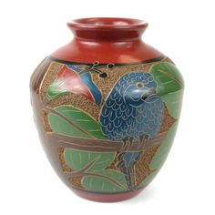 6 inch Tall Vase - Parrot - Esperanza en Accion This decorative vase from Nicaragua is 6 inches tall and 5 inches in diameter, featuring a parrot design. This is low fired and not designed to hold water. Tall Vases, Pottery Vase, Vases Decor, Handmade Pottery, Decorative Accessories, Artisan, Ceramics, Fair Trade, 6 Inches