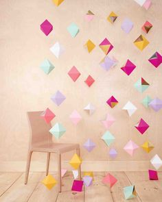 15 DIY Photo Booth Backdrops to Upgrade Your Wedding Reception | Martha Stewart Weddings - This cheery backdrop can come together in one afternoon of crafting. Make some of these multifaceted beauties, thread them onto string or monofilament, and, voilà, multidimensional décor to add color and depth to any photo.