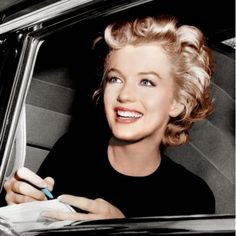 MARILYN MONROE: Just 20--Here the film star is just 20 whilst signing autographs. Her career is on the upward swing and she is starting to become the most recognizable star in Hollywood.