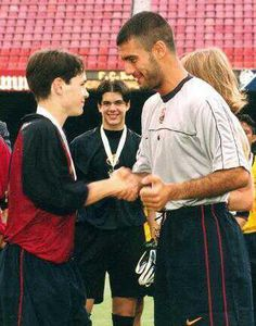 Andrés Iniesta, FC Barcelona youth section (1996-2001) and his idol Josep 'Pep' Guardiola, FC Barcelona (1990-2001). He won with FC Barcelona cadet team, the Nike Premier Cup in 1999 and was elected best player of the tournament at the age of 15, and marks the winning goal at the last minute in the final. Guardiola gave him the cup.