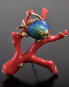 "Coral and Enamel Fish Brooch, 18K gold ox blood coral branch and enamel fish brooch 2 1/4"" x 2 5/8"" 30.8 grams"