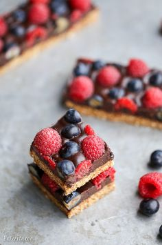 These Chocolate Berry Bars have an almond flour crust topped with vegan chocolate ganache and fresh raspberries and blueberries. These dessert bars are beautiful, delicious, and better for you - they're gluten-free, vegan, refined sugar-free, and Paleo.