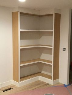 The first big projects we tackled right after I had Anna were two sets of built-in bookshelves– one in the playroom, and one in the front room. When I say right after, I mean right after, as in a few