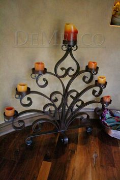 """This custom wrought iron candle holder is manufactured from solid 2"""" X 3/8"""" flat bar."""