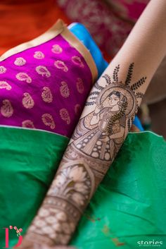 Real Indian Wedding - Aditi and Shubham | WedMeGood | Intricate Detailed Mehendi with Bride and Lotus Caricatures Picture Courtesy: @storiesbyjr #wedmegood #indianmehendi #indianwedding #bridal