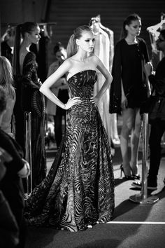 Pin for Later: If You Thought Catwalk Couture Looked Amazing, Wait Until You Go Backstage  A Zuhair Murad model waits for her turn on the catwalk.