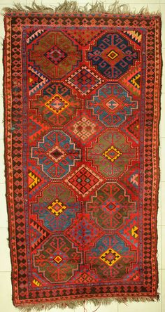 This lovely old rug would be compelling against a natural stone floor.