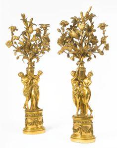 A pair of Louis XVI ormolu three-branch candelabra circa 1775 - Sotheby's