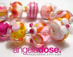 Mmmmm beads! #angeladosedesign #lampwork #homestudiolife ##104coe #handmadebeads #pink #juicyjuice #sunshine #happysundaypeeps #lovemyjob #makinbeads