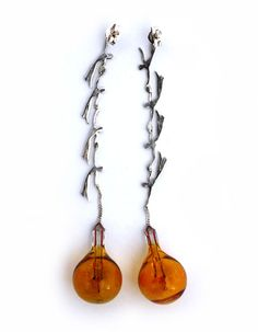 "Rallou Katsari – ""Lifesaving Dance"". Earrings. Silver, light bulb."