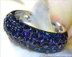 The entire ring head is paved in five rows with finest blue sapphires (flawless finish, best brilliance and purity).
