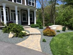 """Changed over from Black Mulch to a 3/4"""" Blue-Gray Traprock."""
