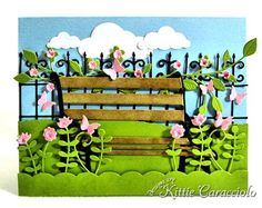 KC Madison Park Bench - Poppy stamps Madison Park Bench -My project today was made using the new Poppystamps Madison Park Bench.  I tired to create a park setting with the vines, flowers and the wrought iron fence in the background that matched the iron on the bench. I may have covered up the ends of the bench a little too much with the flowers but I never seem to be able to resist.  I thought the summer border was perfect in the foreground with the lavish branch on the fence.