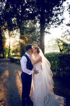 The bride and the Groom share a kiss as the sun sets. Groomswear by Louis Copeland & Sons. Photography by: Ros from Couple Photography. Wedding Blog, Wedding Photos, Real Weddings, Destination Weddings, Wedding Couples, Couple Photography, Florence, Countryside, Groom