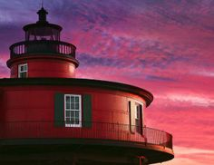 This red and rotund lighthouse makes for a lovely composition in front of the pink evening sky. Interestingly, it is no longer found in its original location: the Seven Foot Knoll Lighthouse has abandoned its place at the mouth of Maryland's Patapsco River and now sits as a landmark on the Inner Harbor waterfront in downtown Baltimore.    Built in 1856, Seven Foot Knoll is the oldest screw-pile lighthouse that's still intact.
