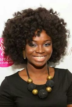 I love her curl pattern! & The style is great! The curls look soft, loose, and full!