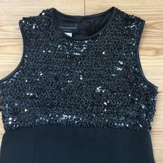 """✨VINTAGE EARLY 80's EVAN-PICONE SHEATH✨ This is from my mother-in-laws closet.  It is in """"like new"""" condition.  Evan-Picone long sleeveless sheath.  Gorgeous sequined bodice (sequins are black w/ small white polka dots) the bodice has some stretch to it and buttons up on the back of the bodice.  The bodice is made of nylon and the bottom is polyester.  Super holiday dress!!!  Measurements:  armpit to armpit= 20"""" waist= 18"""" and is 50"""" long (measurements were taken laying flat) Evan Picone…"""