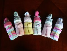These diaper babies are ready to ship and are created exactly as pictured.  This set of diaper babies would be adorable tucked into a basket with baby supplies or a cute addition to baby shower decor! They each measure approximately 6.5 tall and all items are completely usable when disassembled.  Set of 6 diaper babies includes: - 6 Size 1 Pampers Swaddlers Diapers - 6 Baby Washcloths - 3 Pairs of Baby Socks - High Quality Ribbon  The set will be wrapped in clear cellophane and tied with a…