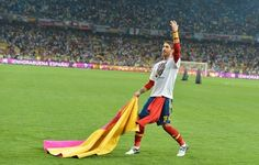 Spanish defender Sergio Ramos salutes the crowd with a matador cape 'capote' after the Euro 2012 football championships final match Spain vs Italy on July 1, 2012 at the Olympic Stadium in Kiev. Spain won 4-0.