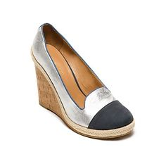 Tommy Hilfiger women's shoe. Our espadrille wedge stands a part in silver metallic leather and navy suede. Not only are they flattering, their lightweight construction makes them exceptionally comfortable too. <br>• Wedge silhouette with leather upper.<br>• Raffia heel, padded insole, textured rubber outsole.<br>• 4.5'' heel with 1'' platform.<br>• Imported.<br>