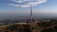 Stock Footage | Aerial of Radio / Telecommunications Tower | Download using the VidLib app. 50.000 Royalty Free Clips'