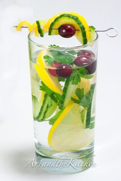 large pitcher of cold filtered water 1 lemon thinly sliced 1/2 cucumber thinly sliced small bunch cilantro (stems cut off) small bunch Italian parsley (stems cut off) handful of frozen cranberries