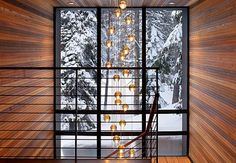 Ski house in Sugarbowl, CA-- love the light fixture in the stairwell    http://www.casasugar.com/Tahoe-Ski-Cabin-Modern-Architecture-Photos-20876216?page=0,0,1