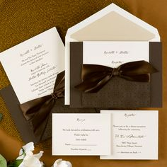 "An ecru invitation card is held securely in an intricately, designed mocha pocket that is tied with a 20"" pre-cut mocha ribbon. Enclosure cards are available to complete this ensemble.   7 3/4"" x 5 1/2"""