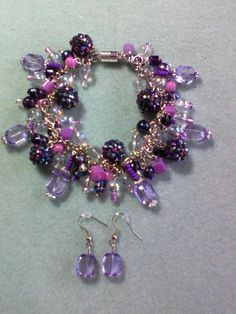 Glass bead bracelet and earrings I made for my daughter's friend. She LOVES purple!