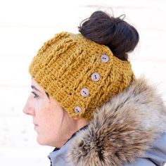 """The """"cabled"""" look of this free crochet bun beanie pattern is worked in only single crochet and chain stitches! Free pattern and video tutorial."""
