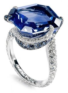 De Grisogono. A 23.18-Carat-emerald-cut blue sapphire surrounded by 107 blue sapphires and 224 white diamonds in white gold.